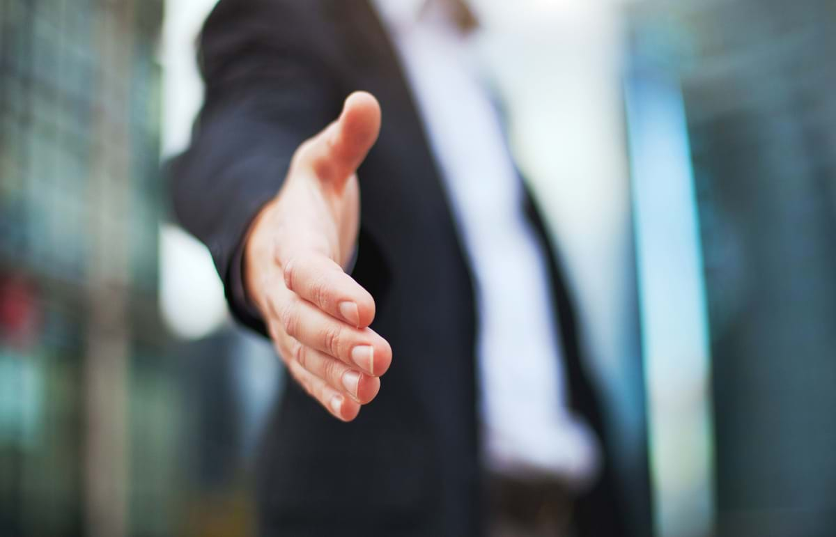 Hand Outstretched for Handshake, Business Partnership/Customer Service Concept