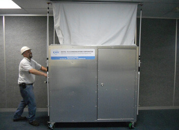 Employee in Hard Hat Pushing the Infectious Control and Dust Containment Mobile Unit